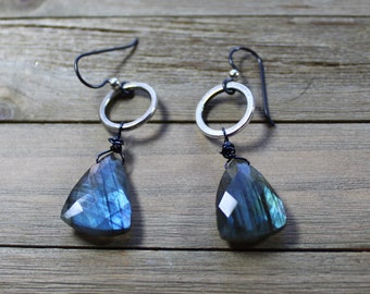 Faceted labradorite triangle suspended from silver circle, and hanging from niobium black earwires (nickel free)