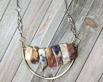 Petrified wood tooth bead stone graduated U bar statement necklace with geometric gold colored chain