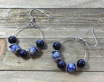 CLEARANCE! Sparkly blue goldstone and blueberry sodalite with silver bead caps in silver hoop suspended from silver french hooks