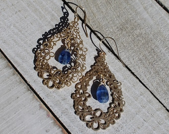 Polished kyanite briolette beads, suspended inside 16k gold filigree butterfly / flower teardrop on 14k gold filled ear wires
