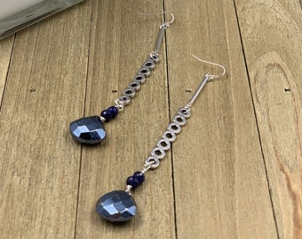 Blue pyrite briolettes with genuine sapphire beads, suspended from silver circle bars and are hanging from 925 sterling silver earwires