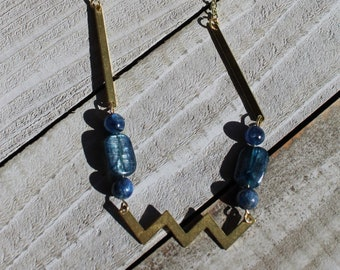 Geometric brass and polished kyanite beads with wavy brass bar on with kyanite polished beads on a brass chain