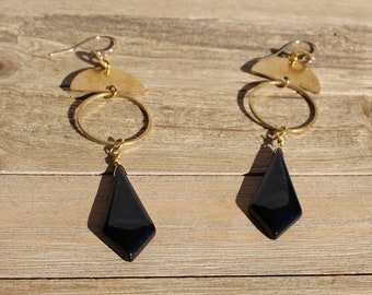 Black onyx tie shaped stone suspended from brass circles and half circles on 14k gold filled ear wires