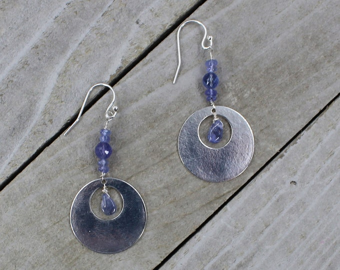 Genuine tanzanite stones with silver circles hanging from 925 sterling silver earwires