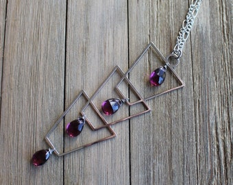 Silver geometric pendant with faceted kunzite quartz stones on long silver chain with s hook clasp close