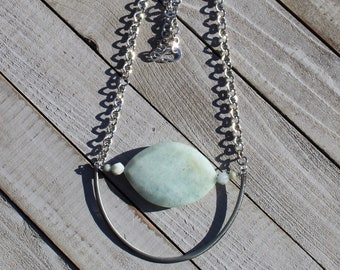 Large faceted aquamarine pendant and star cut aquamarine beads with silver geometric shape on sparkly silver chain