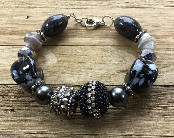 Unique black silver grey glass metal large bead statement bracelet has rhinestone hematite spikes on silver wire closes with lobster clasp
