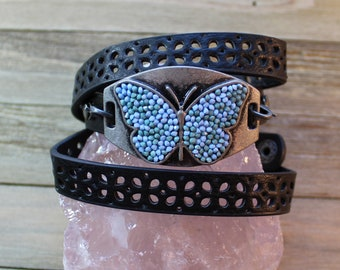 Black punched triple wrap leather adjustable bracelet with blue & green butterfly on silver plaque attached w lobster clasp snap secured