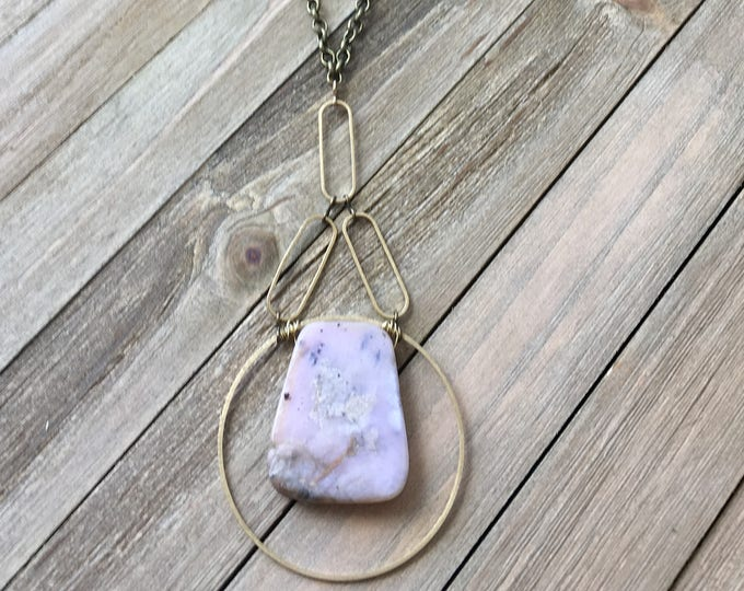 Geometric funky peruvian pink opal pendant inside brass circle suspended from brass ovals on antique gold chain