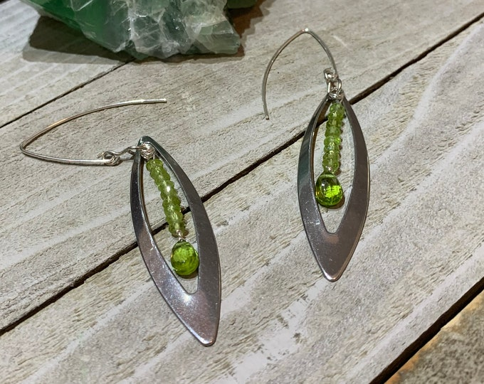 Featured listing image: Faceted peridot stones inside stainless steel marquis shape, connected to 925 sterling silver french hook earwires