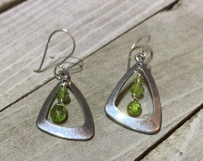Peridot stones suspended inside stainless steel triangle, and hanging from 925 sterling silver french hook earwires