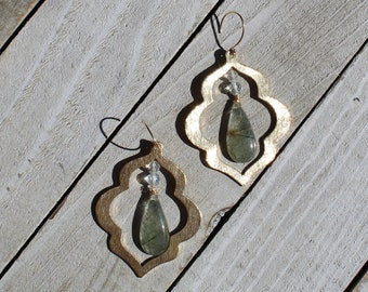 Rutilated green quartz briolette an white topaz suspended from brass arabesque shape on 14k gold filled ear wires