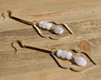 Coated rainbow moonstone suspended inside brass cloud shapes with matte round moonstones on 14k gold filled ear wires