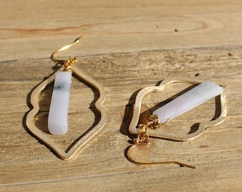 Green and white jade stones suspended under brass findings, attached to 14k gold filled earwires