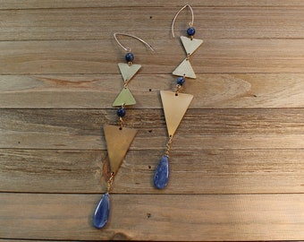 Polished kyanite round and teardrop beads, suspended from brass triangles hanging on 14k gold filled ear wires