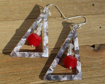 Geometric grey tortoise resin triangles with white topaz and red glass faceted beads suspended in shoulder dusters on silver french hook