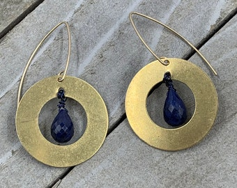 Faceted polished sapphire briolette suspended inside brass circle shapes on 14k gold filled ear wires