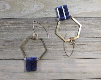 Transparent iolite stone beads, suspended from brass octagon shapes on 14k gold filled earwires