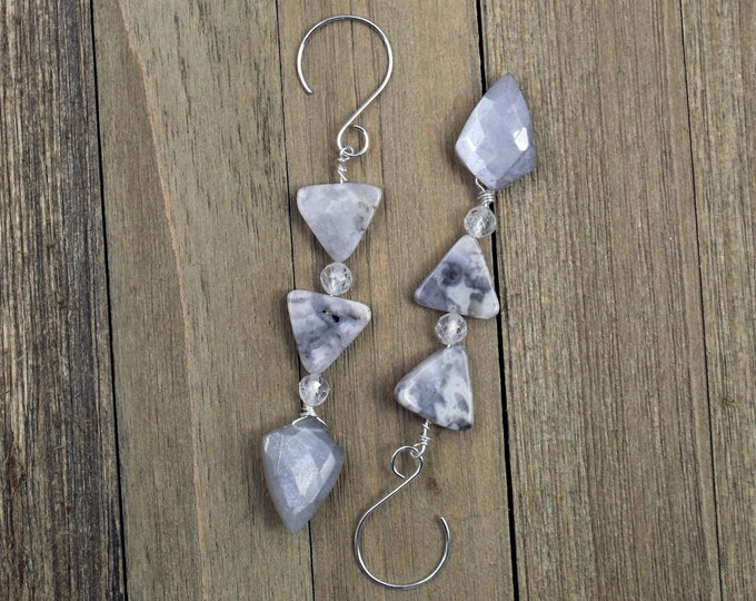 Gray crazy lace agate triangle shaped stones with white topaz and gray chalcedony stones, hanging from 925 sterling silver earwires