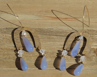 Teardrop shaped light blue chalcedony gemstone earrings with brushed gold U shapes with white topaz stones on 14k gold filled earwires