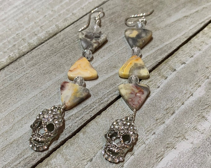 Crazy lace agate triangle shaped beads with white topaz and silver rhinestone skulls on sterling silver earwires