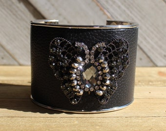 Silver, black leather & rhinestone gunmetal butterfly embellishment inlaid cuff bracelet