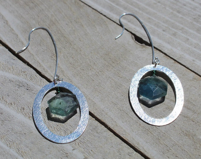 Octagon purple and green fluorite suspended inside silver ovals, attached to silver 925 sterling silver french hooks