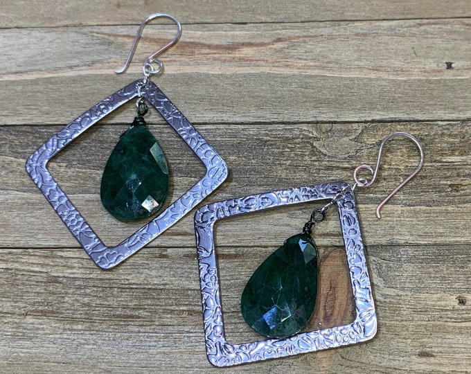 Featured listing image: Faceted polished emerald suspended inside stainless steel square shapes with embossed flowers on 925 sterling silver ear wires