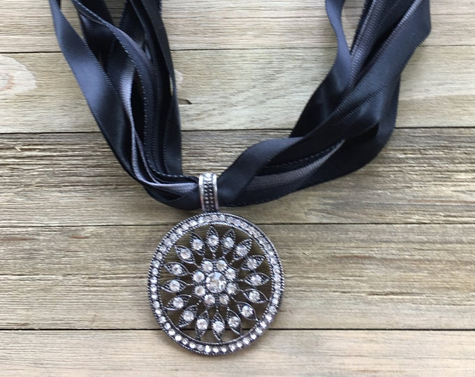 CLEARANCE! Silver rhinestone circle sparkly medallion on multi-ribbon necklace, closure antique silver with embedded rhinestones