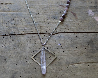 Raw kunzite with square floating pendant with lantern shaped strawberry quartz embedded as accent in silver chain
