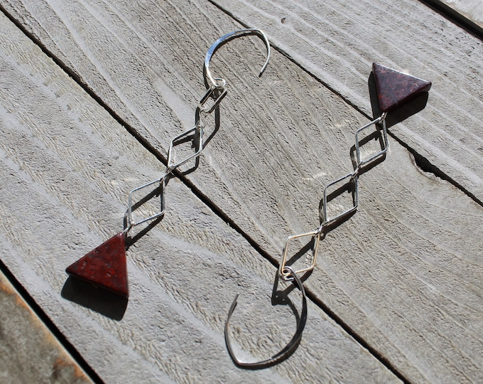 Red poppy jasper triangle beads suspended under silver diamond shaped connectors on 925 sterling silver ear wires