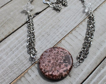 Pink Mexican jasper coin pendant with herkimer diamonds suspended from silver chain