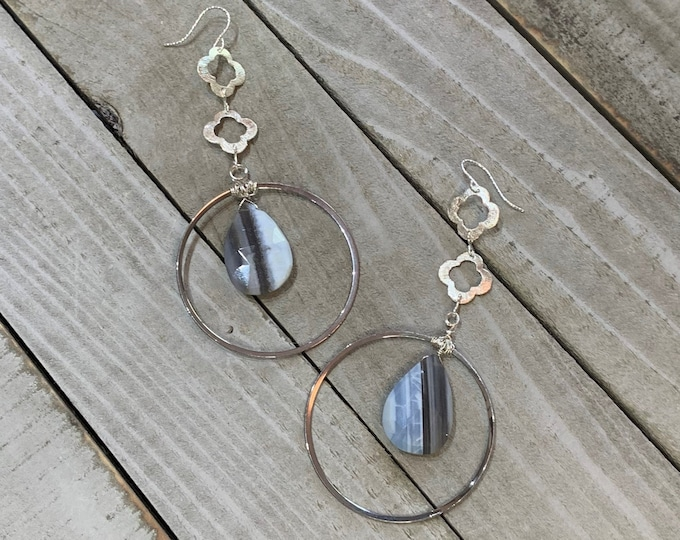 Blue Oregon boulder opal faceted briolettes inside silver polished circles with quatrefoil geometric shapes on 925 sterling silver earwires
