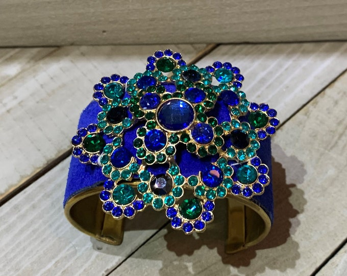 Brass, blue suede leather & flower rhinestone embellishment on an inlaid leather on gold metal cuff bracelet
