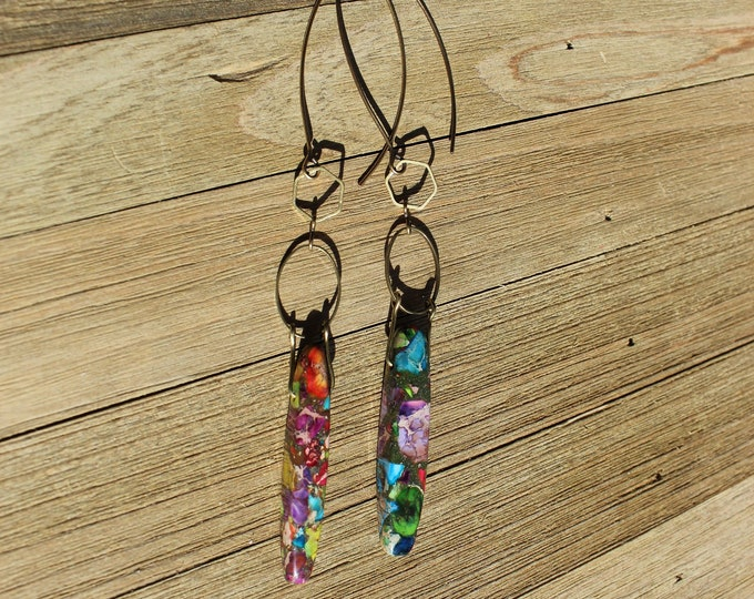 Rainbow sea sediment jasper teardrops hanging from brass geometric shapes, on nickel free antique gold colored french hook earwires