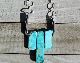 Bright turquoise blue imperial sea sediment jasper graduated tooth beads suspended from silver chain with silver hexagons and silver tubes