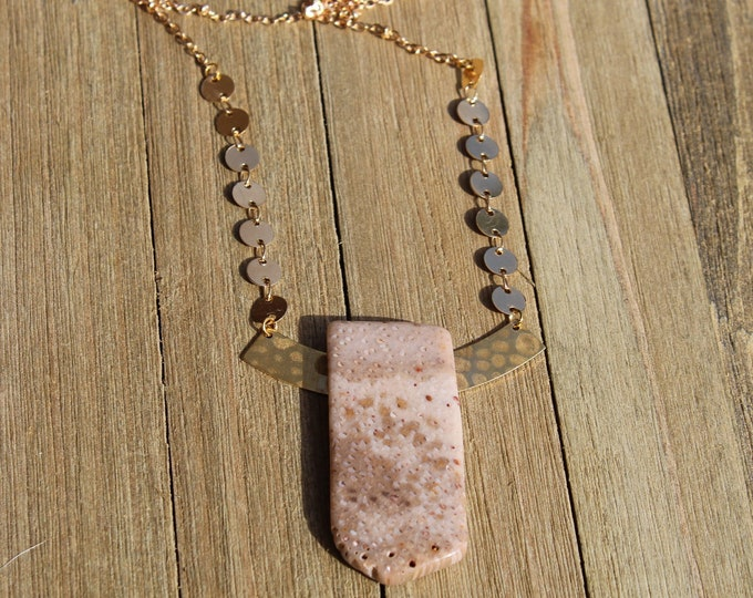 Natural brown and beige ocean jasper pendant with brass geometric shapes on a gold toned chain