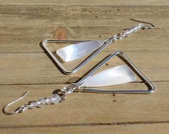 White selenite stones suspended inside silver triangle shapes with white natural topaz on 925 sterling silver ear wires