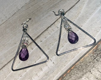 Faceted polished color changing alexandrite suspended inside silver triangle shapes with herkimer diamonds on 925 sterling silver ear wires