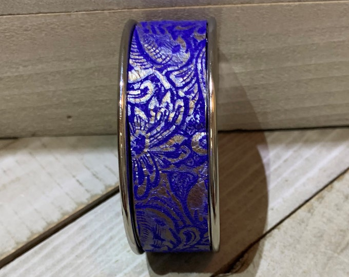 Blue leather with silver print on leather in inlaid silver cuff