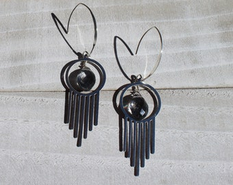 Grey (gray) quartz faceted beads suspended inside stainless steel art deco shaped finding on 925 sterling silver earwires