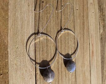 Faceted labradorite coin stone, suspended from silver circle and on long 925 sterling silver french hooks