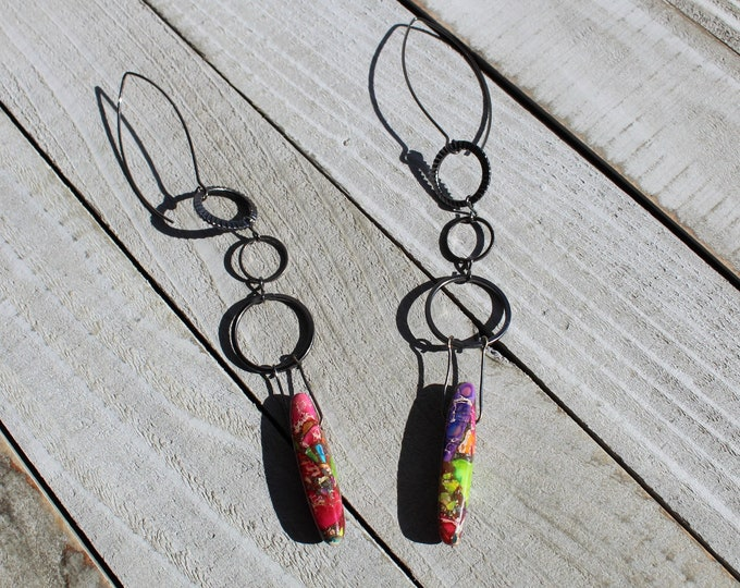 Rainbow sea sediment jasper teardrops hanging from gunmetal circle geometric shapes, on nickel free gunmetal colored french hook earwires