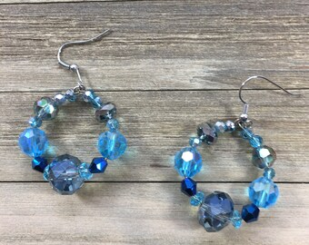 CLEARANCE! Beaded round earrings in various colors of blue including iridescent glass beads on a silver french hook