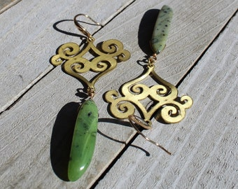 Green and black British Columba jade stones suspended under brass findings, attached to 14k gold filled earwires