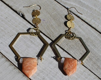 Orange and rainbow moonstones suspended inside brass octagon and circle shapes on 14k gold filled ear wires