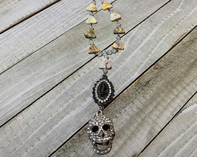 Upcycled funky large rhinestone skull pendant with crazy lace agate triangles and white topaz on silver chain