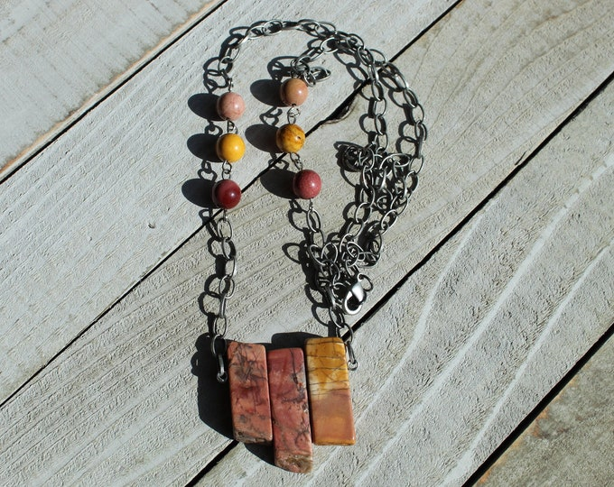 Red creek jasper stick bead pendant with red creek jasper bead accents on brushed silver necklace