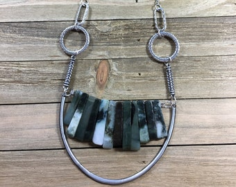 Variegated green and white jade stick bead stone necklace with silver U accent on funky silver geometric chain