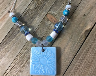 CLEARANCE! Blue ceramic tile with etched flower pendant accented with sea glass, magnesite and czech lampwork beads on silver chain